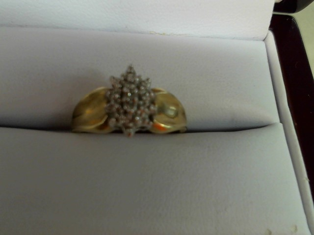 Lady's Diamond Cluster Ring 3 Diamonds .06 Carat T.W. 10K Yellow Gold 3.1g