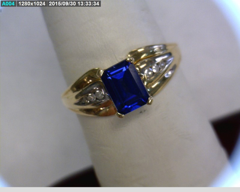 Blue Stone Lady's Stone & Diamond Ring 6 Diamonds .06 Carat T.W.
