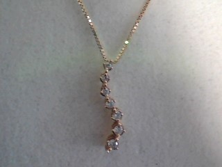 Diamond Necklace 7 Diamonds .14 Carat T.W. 10K Yellow Gold 0.8dwt
