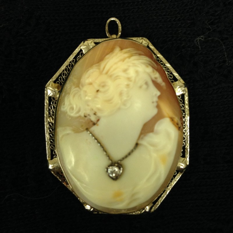 BEAUTIFUL EARLY 1900'S 14KT WHITE GOLD SHELL CAMEO WITH 10 POINT DIAMOND.  THIS