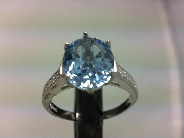 Blue Topaz Lady's Stone & Diamond Ring 12 Diamonds 0.12 Carat T.W. 10K White Gol