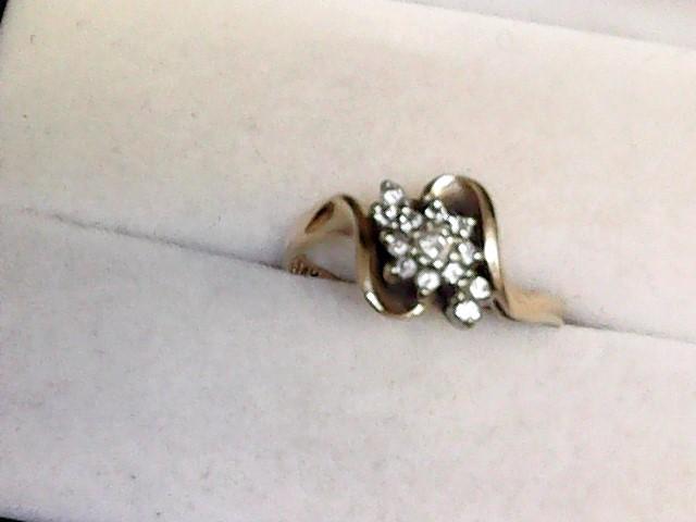 Lady's Diamond Cluster Ring 12 Diamonds .16 Carat T.W. 14K Yellow Gold 2.05dwt