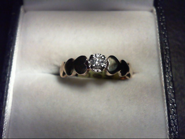 Lady's Diamond Solitaire Ring 0.1 CT. 10K Yellow Gold 2.4g