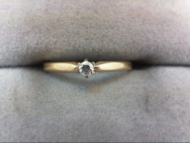 Lady's Diamond Solitaire Ring .05 CT. 14K Yellow Gold 1g