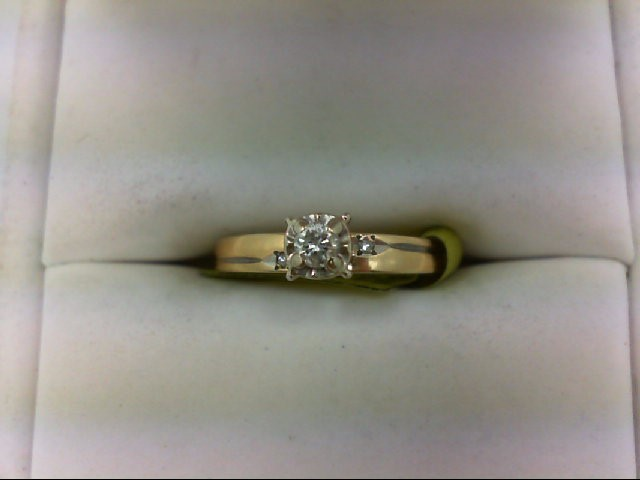 Lady's Diamond Engagement Ring 3 Diamonds 0.1 Carat T.W. 14K Yellow Gold 1.7g Si