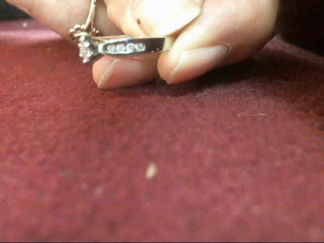 Lady's Diamond Solitaire Ring 9 Diamonds .20 Carat T.W. 10K White Gold 2dwt