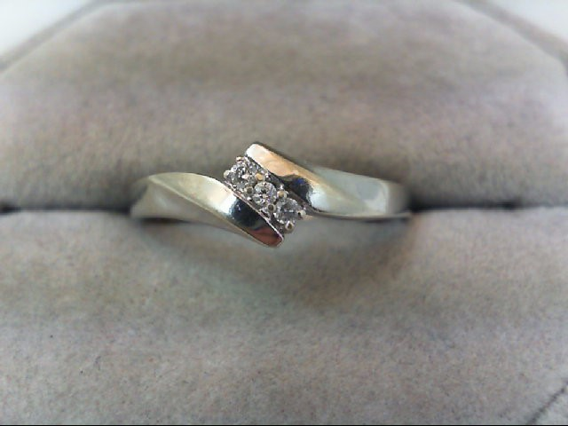 Lady's Diamond Wedding Band 3 Diamonds .09 Carat T.W. 10K White Gold 1.8g