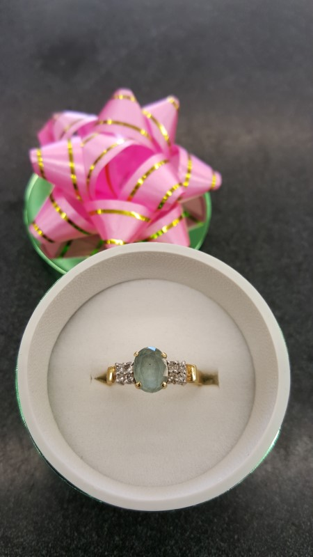 Teal Stone Lady's Stone & Diamond Ring 4 Diamonds .20 Carat T.W.
