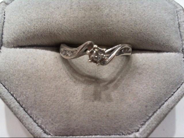 Lady's Silver-Diamond Ring 8 Diamonds .18 Carat T.W. 925 Silver 1.7g
