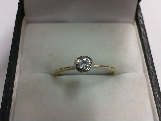 Lady's Diamond Solitaire Ring 0.08 CT. 10K Yellow Gold 1.2g