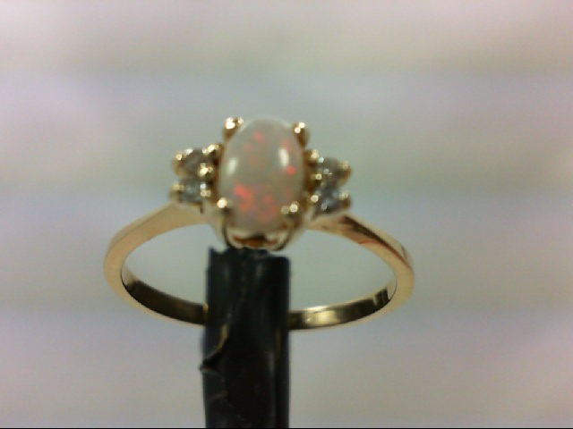 Opal Lady's Stone & Diamond Ring 4 Diamonds .08 Carat T.W. 14K Yellow Gold 1.6g