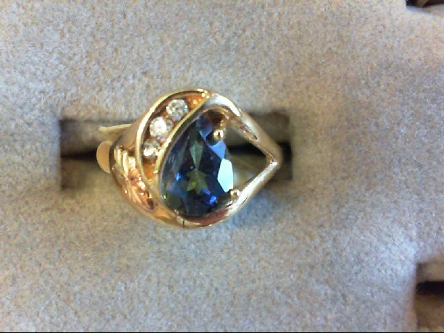 Synthetic Blue Topaz Lady's Stone & Diamond Ring 3 Diamonds .03 Carat T.W.