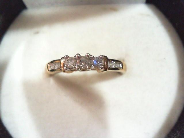 Lady's Diamond Wedding Band 9 Diamonds 0.24 Carat T.W. 10K Yellow Gold 2.2g
