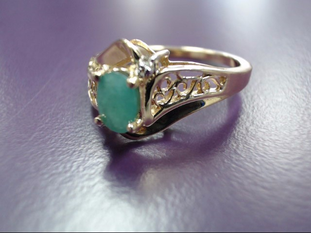 Emerald Lady's Stone Ring 10K Yellow Gold 3.07g