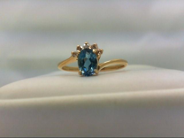 Blue Topaz Lady's Stone & Diamond Ring 5 Diamonds 0.05 Carat T.W. 14K Yellow Gol