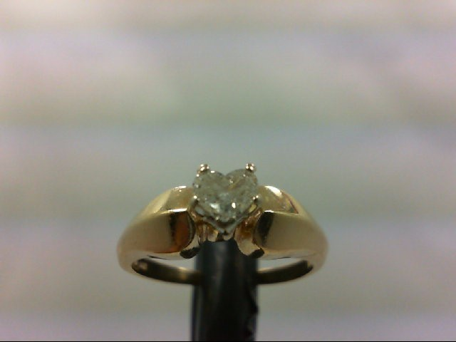 Lady's heart diamond shape Solitaire Ring .23 CT. 10K Yellow Gold 3.3g