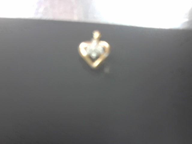 Gold-Multi-Diamond Pendant 7 Diamonds .14 Carat T.W. 10K Yellow Gold 1.3g