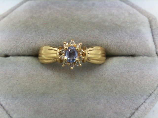 Tanzanite Lady's Stone & Diamond Ring 10 Diamonds 0.1 Carat T.W. 14K Yellow Gold
