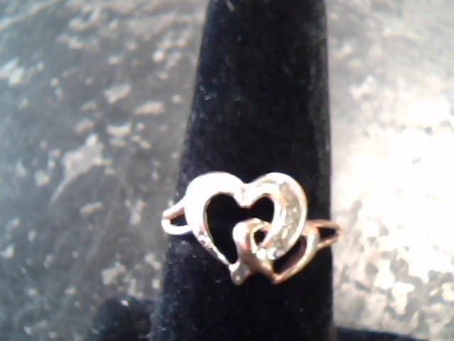 Lady's Diamond Fashion Ring 6 Diamonds .06 Carat T.W. 10K Yellow Gold 1dwt