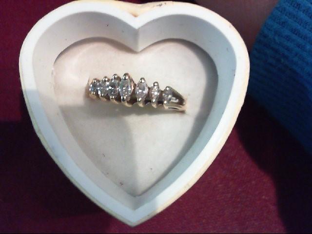 Lady's Diamond Fashion Ring 7 Diamonds .74 Carat T.W. 14K Yellow Gold 2.8g