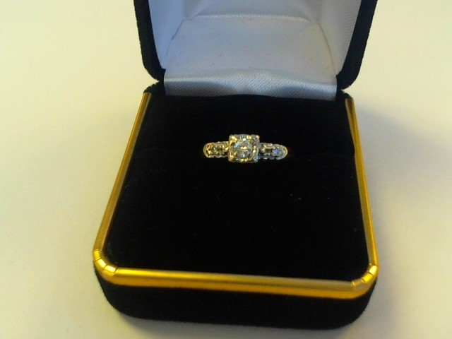 Lady's Diamond Cluster Ring .20 CT. 14K Yellow Gold 1.6dwt