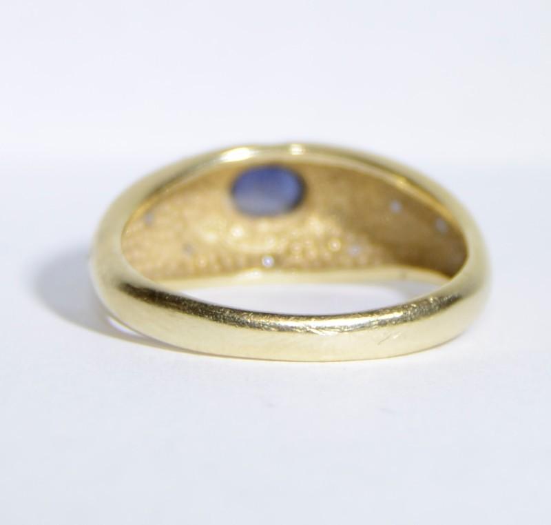 Blue Stone Lady's Stone & Diamond Ring 8 Diamonds .08 Carat T.W.