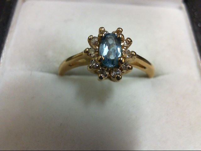 Blue Topaz Lady's Stone & Diamond Ring 10 Diamonds 0.1 Carat T.W. 14K Yellow Gol