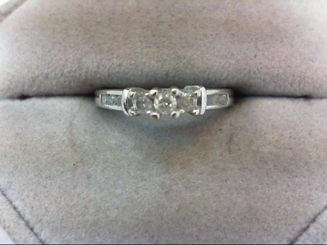 Lady's Diamond Wedding Band 9 Diamonds .22 Carat T.W. 10K White Gold 2.1g