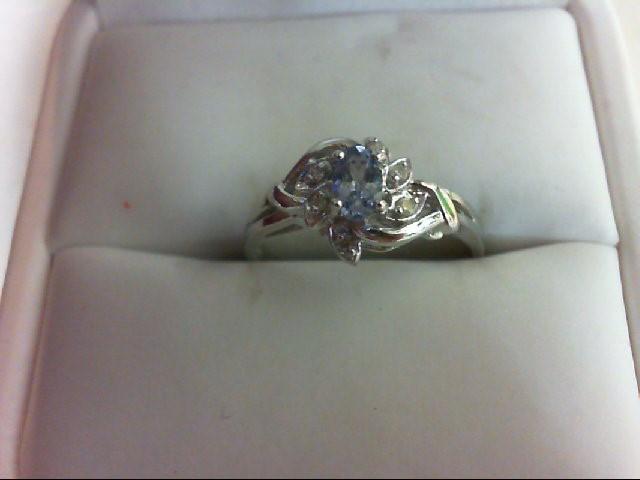 Tanzanite Lady's Stone & Diamond Ring 6 Diamonds 0.06 Carat T.W. 14K White Gold