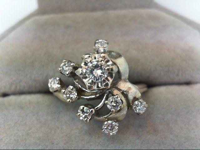 Lady's Diamond Cluster Ring 9 Diamonds .71 Carat T.W. 14K Yellow Gold 4.7g
