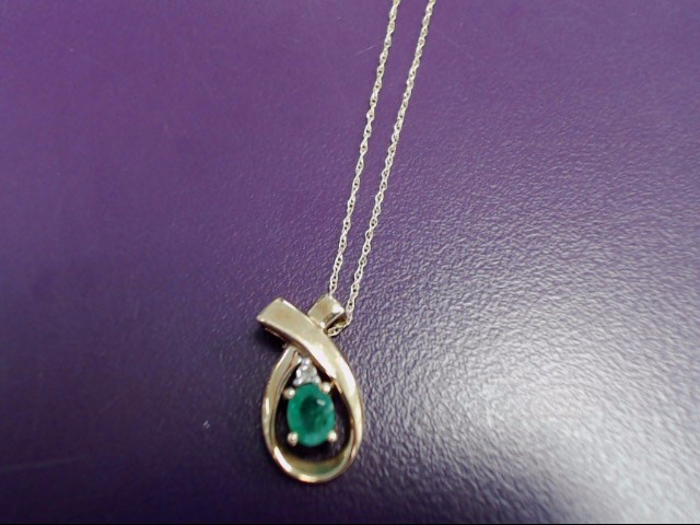 """18"""" Gold Chain 10K Yellow Gold 1.8g with emerald pendant."""