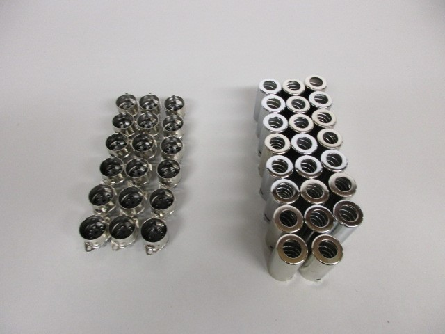 LOT OF EIGHTEEN (18) 9 PIN TUBE SOCKETS AND NINETEEN (19) TUBE SHIELDS. LIKE NEW