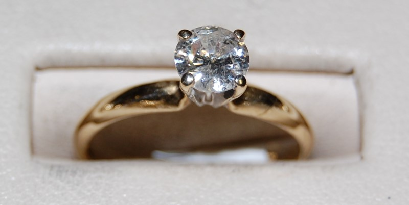 Lady's Diamond Solitaire Ring .61 CT. 14K Yellow Gold 1.9g Size:6.3