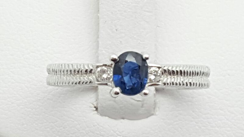 Lady's sapphire & Diamond Ring 2 Diamonds .07 Carat T.W. 14K White Gold 3.