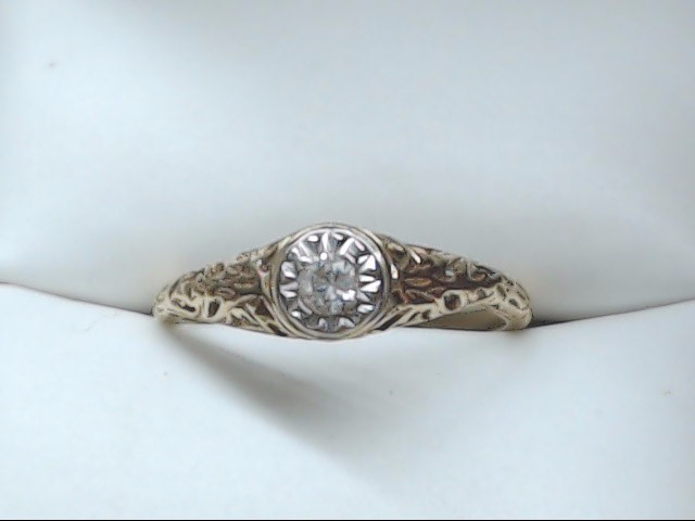 Lady's Diamond Solitaire Ring 0.1 CT. 10K Yellow Gold 1.5g Size:6.25