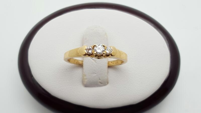 Lady's Diamond Fashion Ring 3 Diamonds .22 Carat T.W. 14K Yellow Gold 2.3g