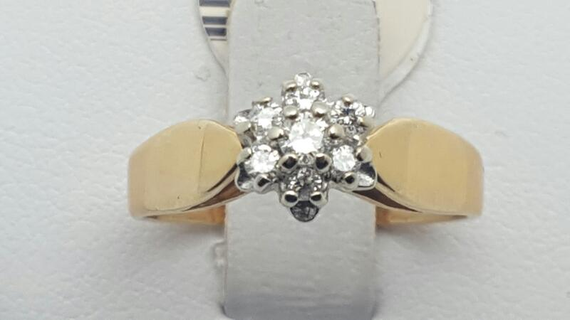 Lady's Diamond Cluster Ring 7 Diamonds .21 Carat T.W. 14K Yellow Gold 3.2g