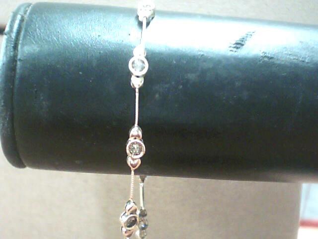 Gold champaig-Diamond Bracelet 10 Diamonds .70 Carat T.W. 10K Yellow Gold 2.7dwt
