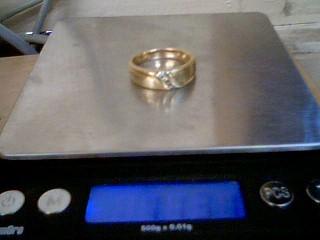 Gent's Gold-Diamond Wedding Band 4 Diamonds .12 Carat T.W. 14K Yellow Gold
