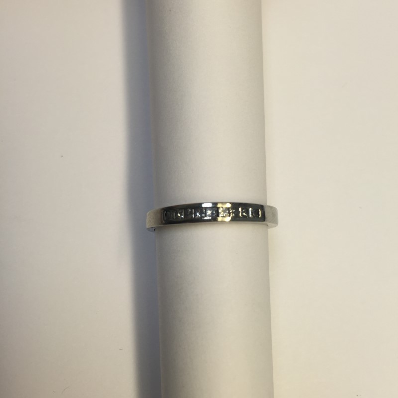 Lady's Diamond Wedding Band 9 Diamonds .18 Carat T.W. 14K White Gold 1.3dwt
