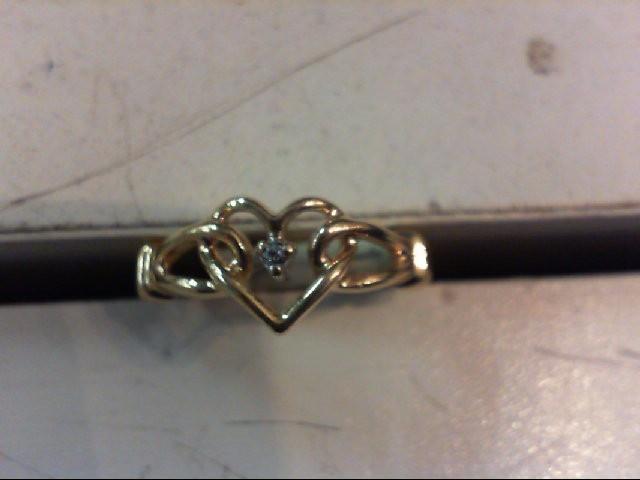 Lady's Diamond Fashion Ring .01 CT. 10K Yellow Gold 1.9g