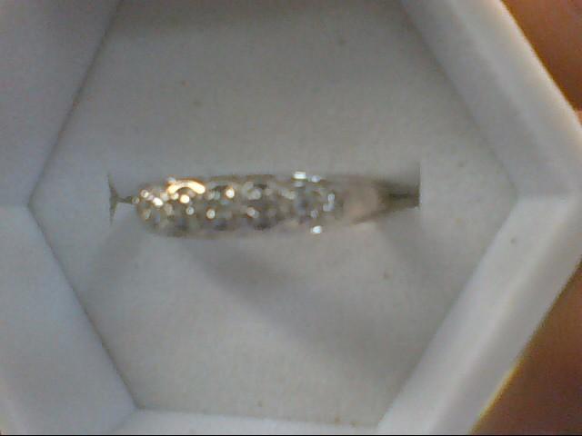 Lady's Diamond Solitaire Ring 7 Diamonds .07 Carat T.W. 14K White Gold 2.1g