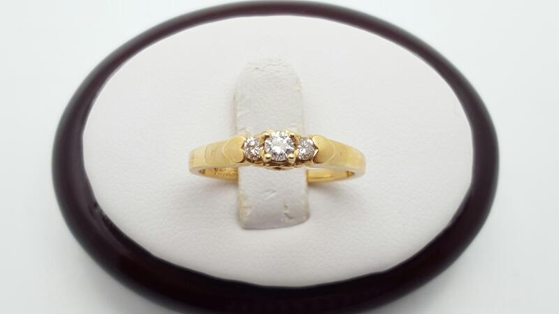 Lady's Diamond Fashion Ring 3 Diamonds .21 Carat T.W. 14K Yellow Gold 2.3g