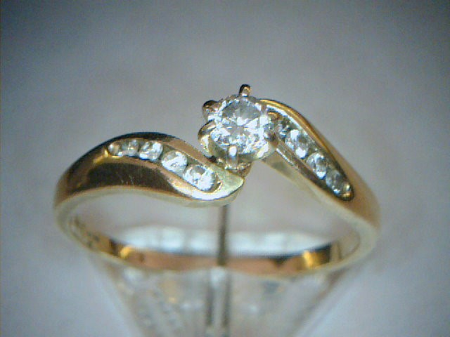 Lady's Diamond Wedding Band 9 Diamonds .29 Carat T.W. 14K Yellow Gold 1.41dwt