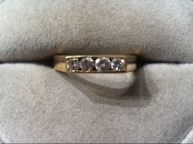 Lady's Diamond Wedding Band 4 Diamonds .30 Carat T.W. 14K Yellow Gold 3.1g