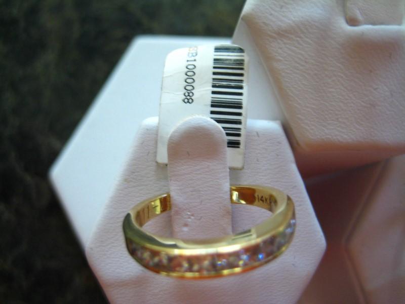 Lady's Gold-Diamond Anniversary Ring 0.01 CT. 14K Yellow Gold 3.7g