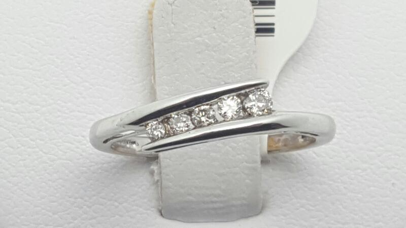 Lady's Diamond Fashion Ring 5 Diamonds .10 Carat T.W. 10K White Gold 1.3g