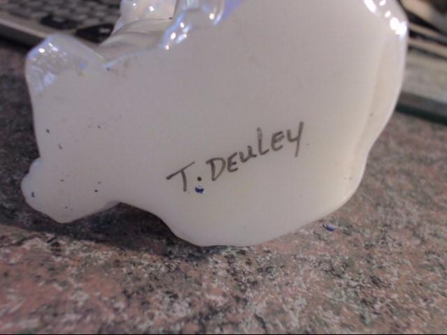 T. DEULEY