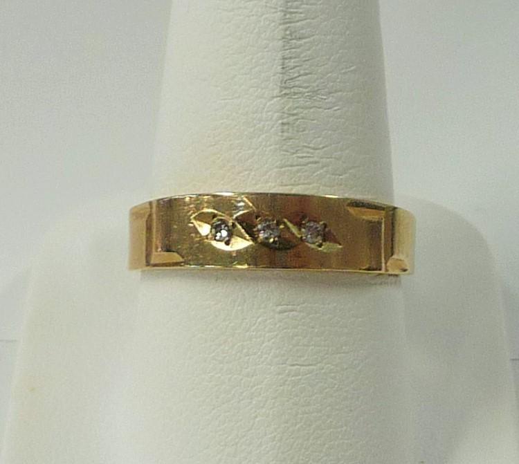 Gent's Gold-Diamond Wedding Band 3 Diamonds .06 Carat T.W. 10K Yellow Gold