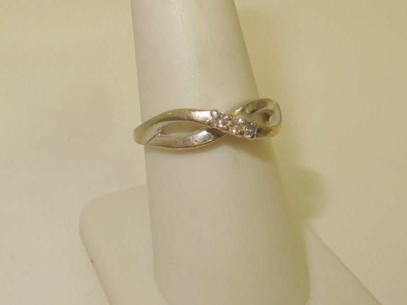 Lady's Diamond Fashion Ring 3 Diamonds .03 Carat T.W. 10K White Gold 2.8g